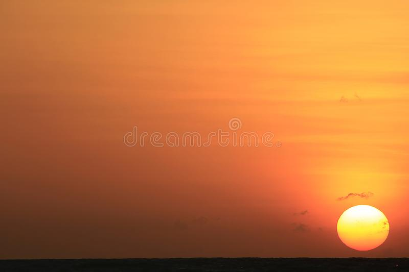 The sun is rising in the morning from the sea. stock photo
