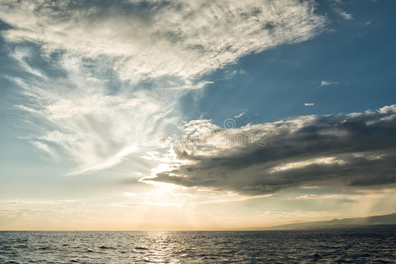 Sun rising ove Pacific ocean stock images