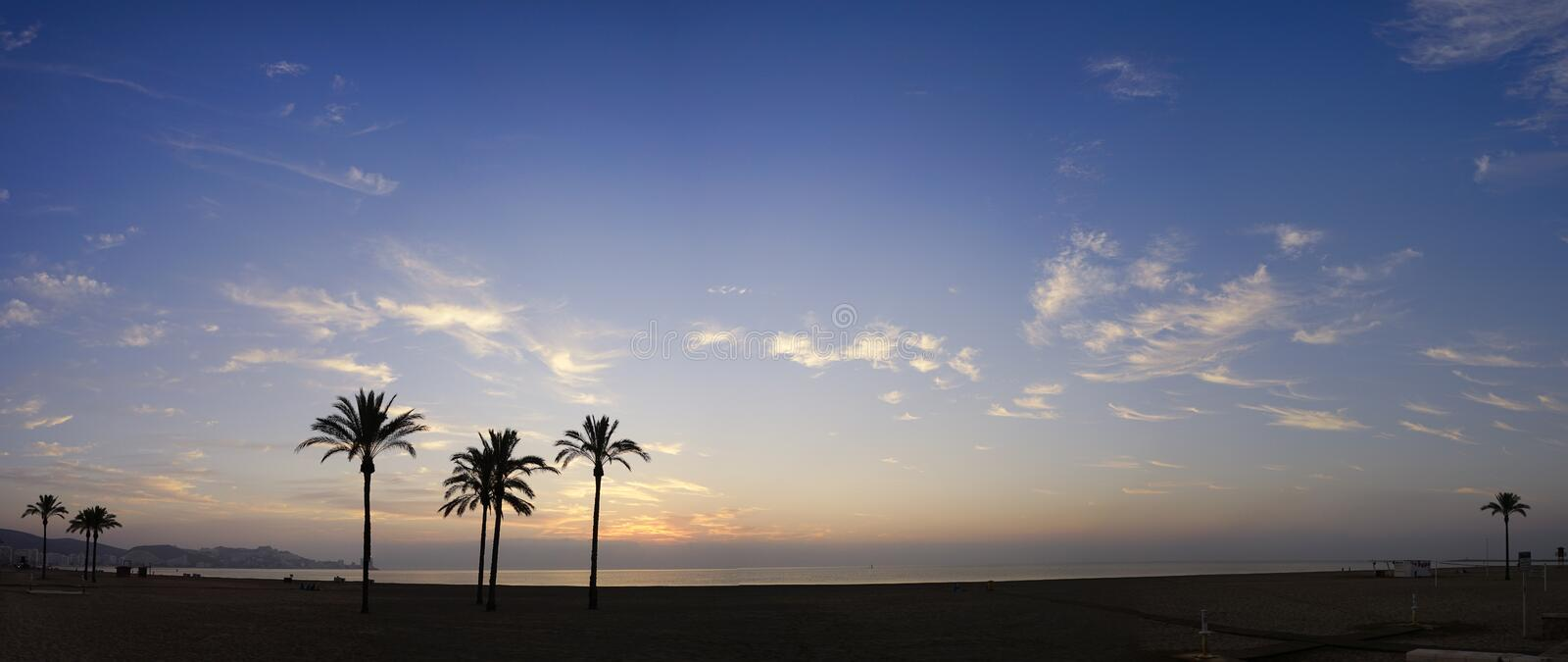 The sun rising over the horizon royalty free stock image