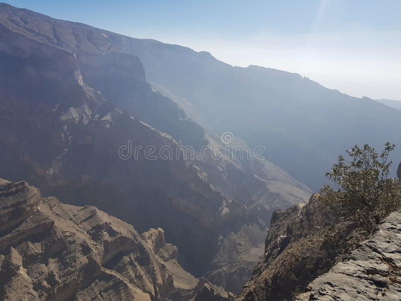Sun in rocks canyon. Sunlight gorge, bright rocks canyon, blue fog in mountains, summer morning in mountains stock images