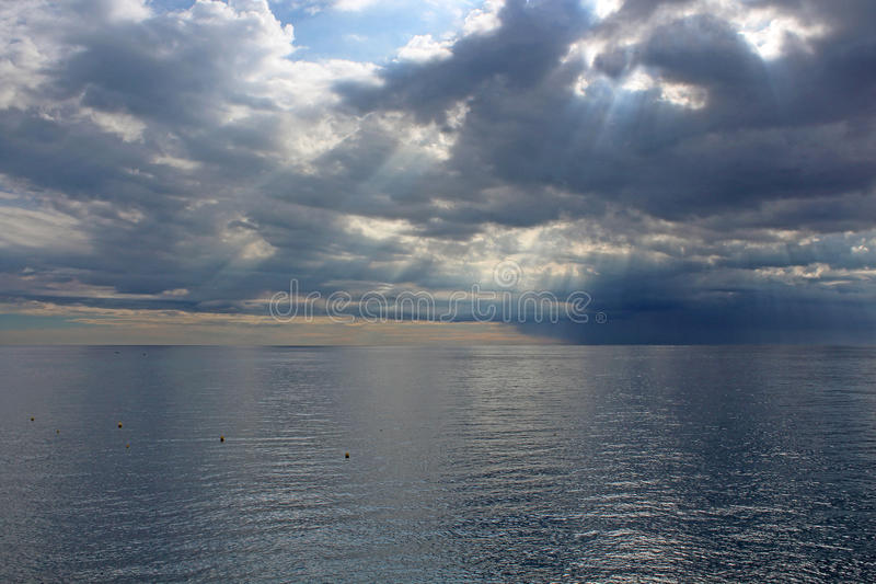 Sun's rays passing through the storm clouds stock photography