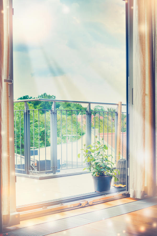 Sun's rays shine into the room through an open window stock photos