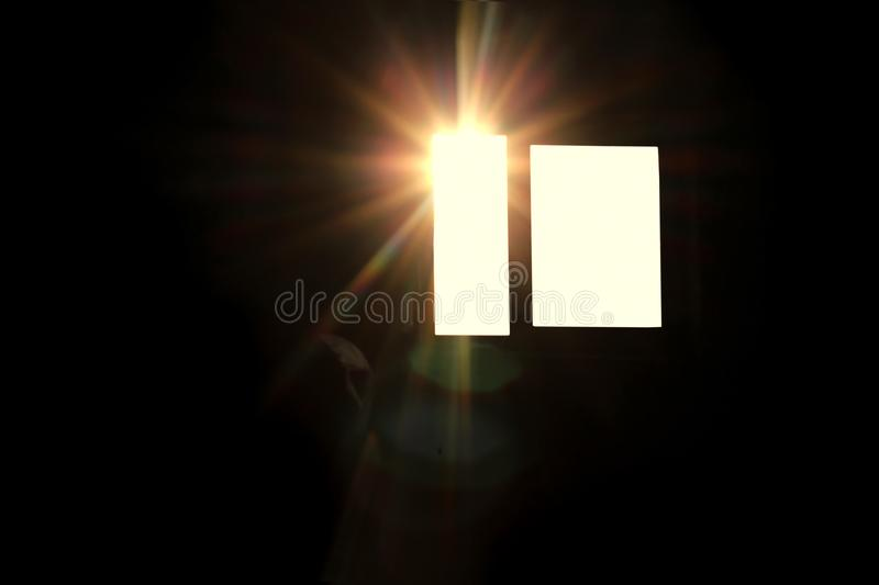The sun`s rays in the window in a dark royalty free stock photo