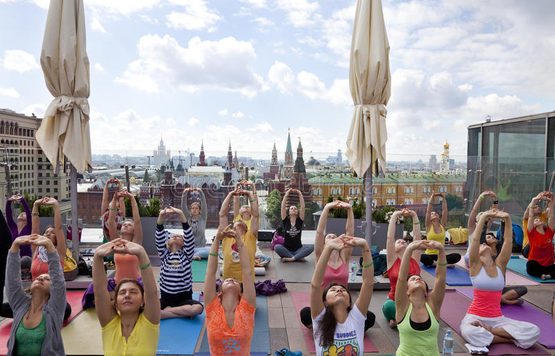 Sun Salutation (Surya Namaskara) in the centre of Moscow, Russia royalty free stock photography