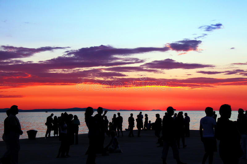 Sun salute. People gathered for a sun salute celebration by the Sea organ in Zadar, Croatia stock images