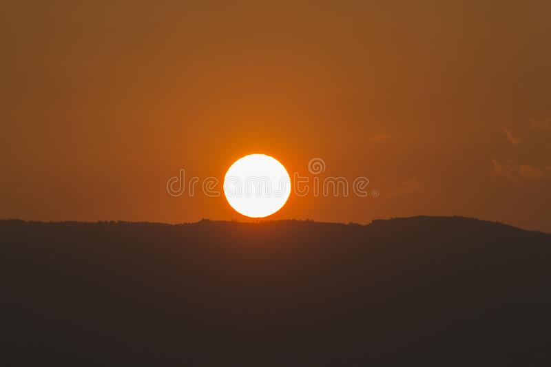 The sun says goodbye to the day royalty free stock photography