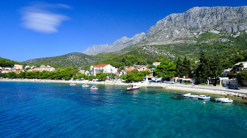 Sun and sea holiday landscape. Croatian coastline: sun, sea and mountains royalty free stock image