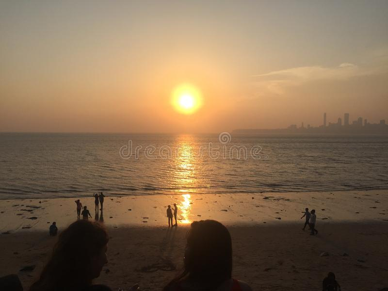 Sun set Beach clouds stock image