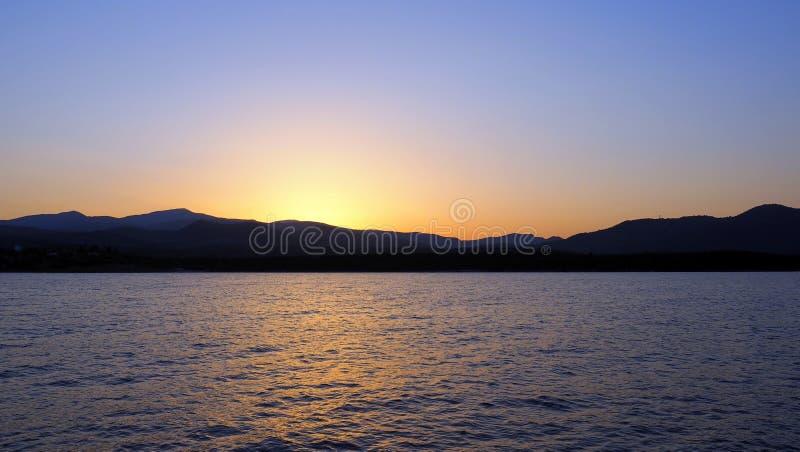 Sun Set Behind a Greek Island stock photos