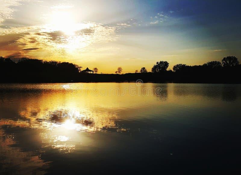 Sun set on the lake stock photos