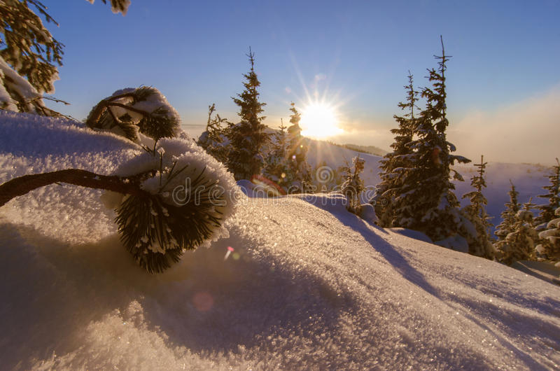 Sun set in mountains with winter and cold scenery royalty free stock image