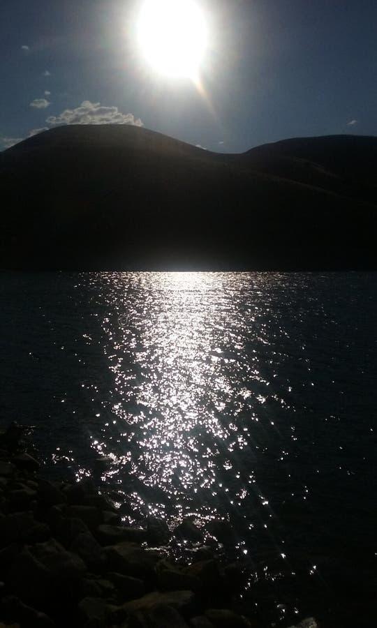 Sun set over the lake royalty free stock photos