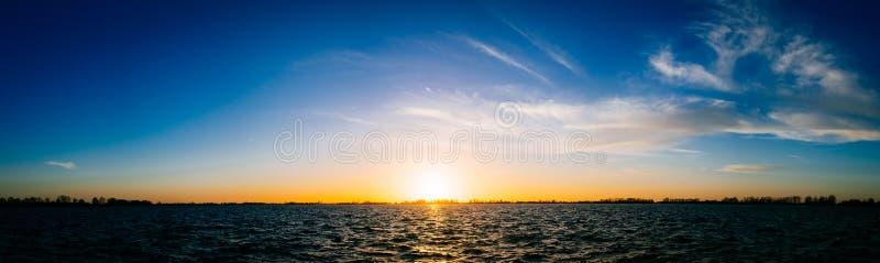 Sun set over lake panorama royalty free stock image