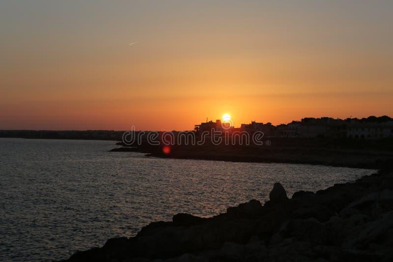 Sun set over rocky coastline stock images