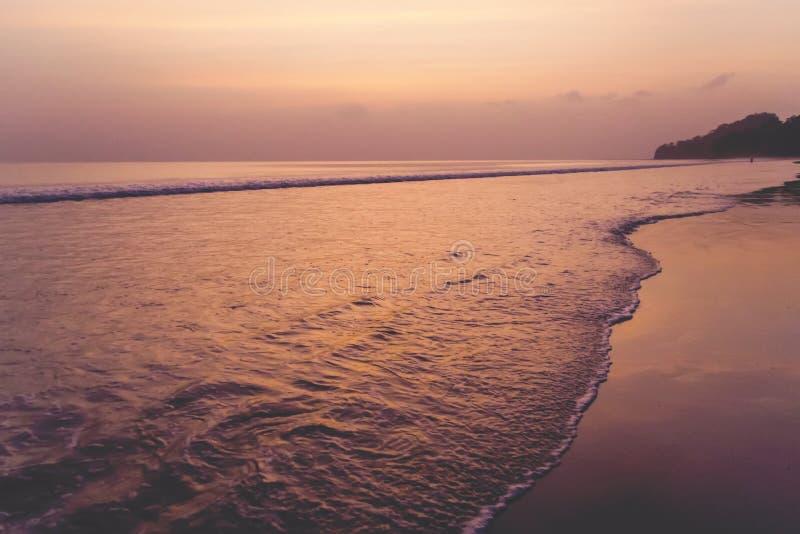 The sun sets on the final days of summer over a beach stock photos