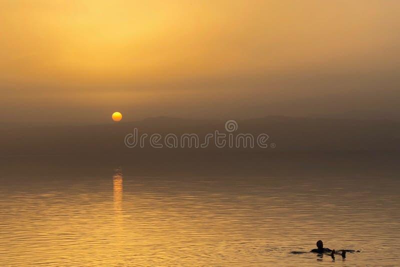 Sun sets on the horizon of Dead Sea in Jordan stock photo