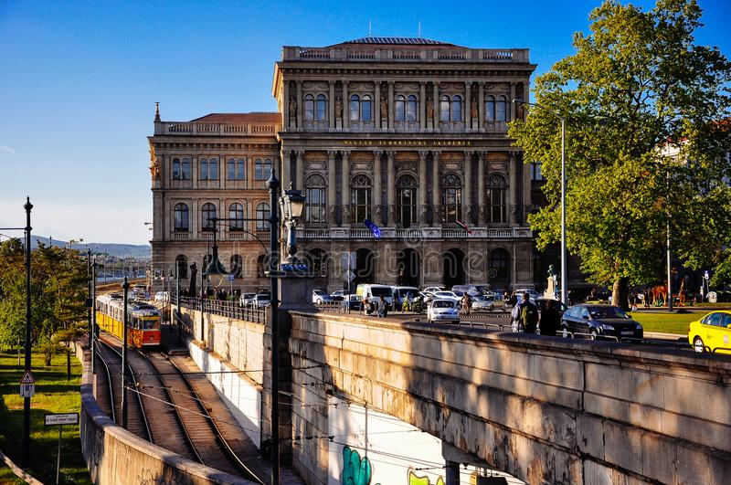 The sun sets on the Hungarian Academy of Sciences in Budapest, Hungary. stock photography