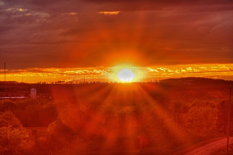 Sun Sets Over A Distant Town royalty free stock image
