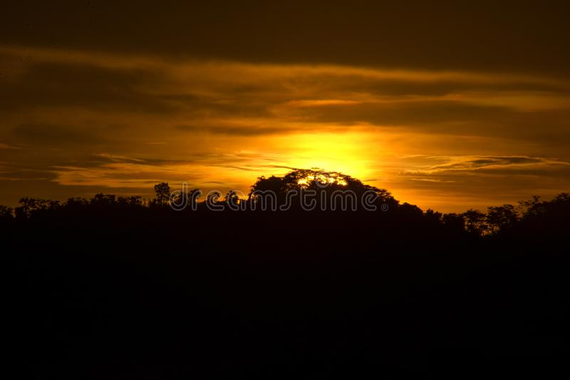 The sun sets over the hills royalty free stock photos