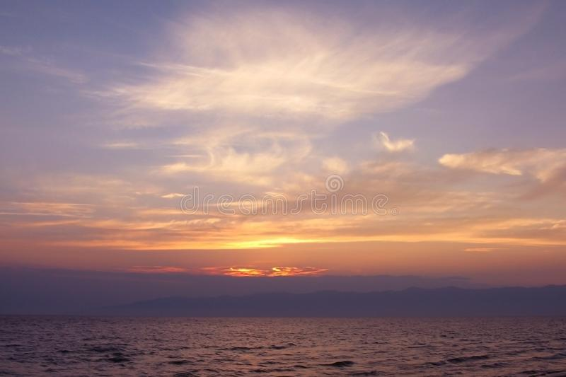 The sun sets over the sea, sunset over the pond, quiet evening, blue haze. Calm mood, meditation, peace stock photo