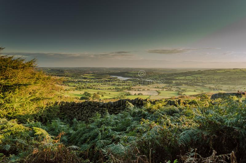 The sun sets over Tittesworth Reservoir and the surrounding fields. On the Roaches in the Peak District National park royalty free stock photos