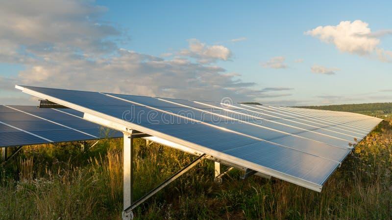 Sun sets on solar panels on energy farm. Sun sets on solar energy farm stock photography
