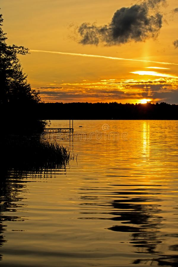 Sun Setting On Bass Lake In Canada`s Wilderness. Sunset on Bass Lake in the Kawartha Lakes region of Ontario, Canada stock photos
