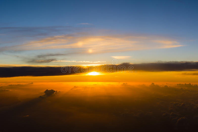 Sun setting behind the clouds. stock photography