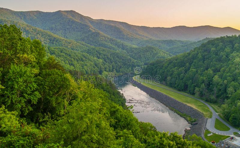 Sunset over the Little Tennessee River. The sun setting behind the mountains over the Little Tennessee River in Swain County North Carolina just below Fontana royalty free stock images