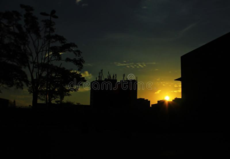 Sun setting between buildings. The day is ending, the spectacle of the night is coming. A moment to admire the spectacle of life that always renews itself royalty free stock photos