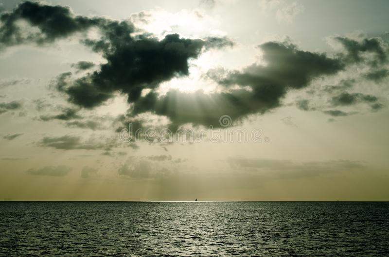 Sun Setting Through Clouds Over Ocean Free Public Domain Cc0 Image