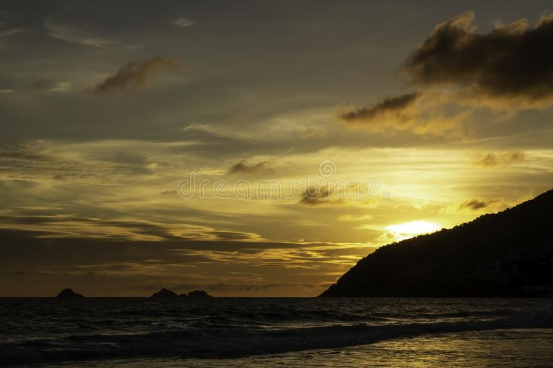Sun setting down over Ipanema beach in Rio de Janeiro royalty free stock images