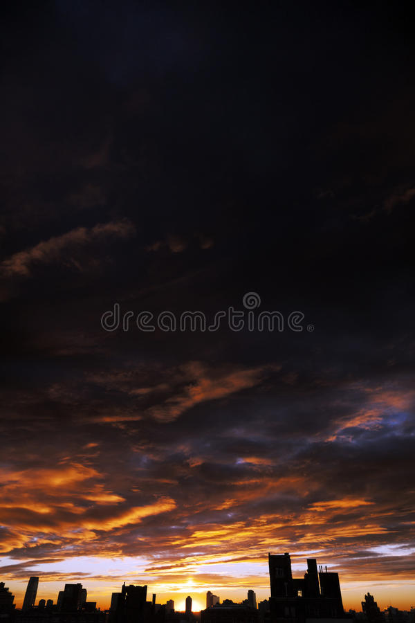 Download Cloudy Sunset Over Urban Skyline Silhouette Stock Image - Image: 29955533