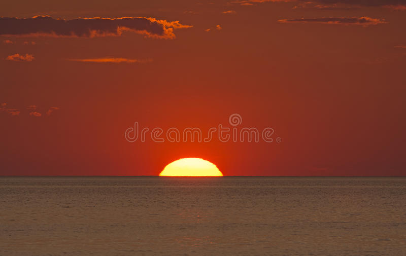 Sun Setting into the Ocean royalty free stock photography
