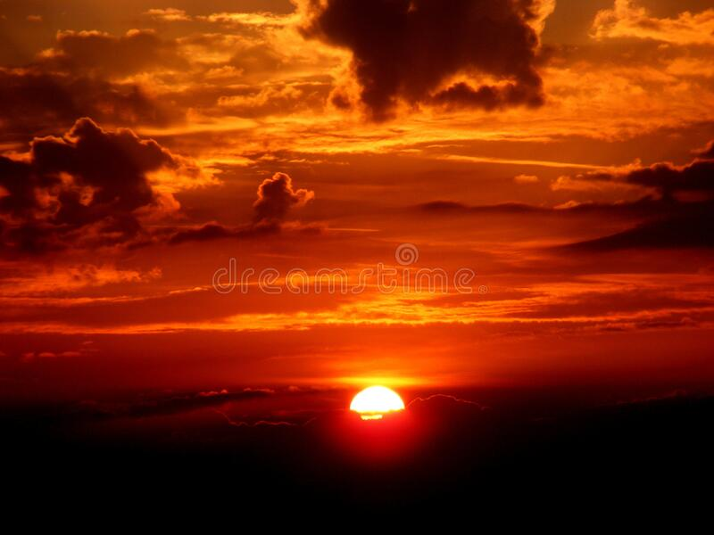 Sun setting in orange skies royalty free stock photo