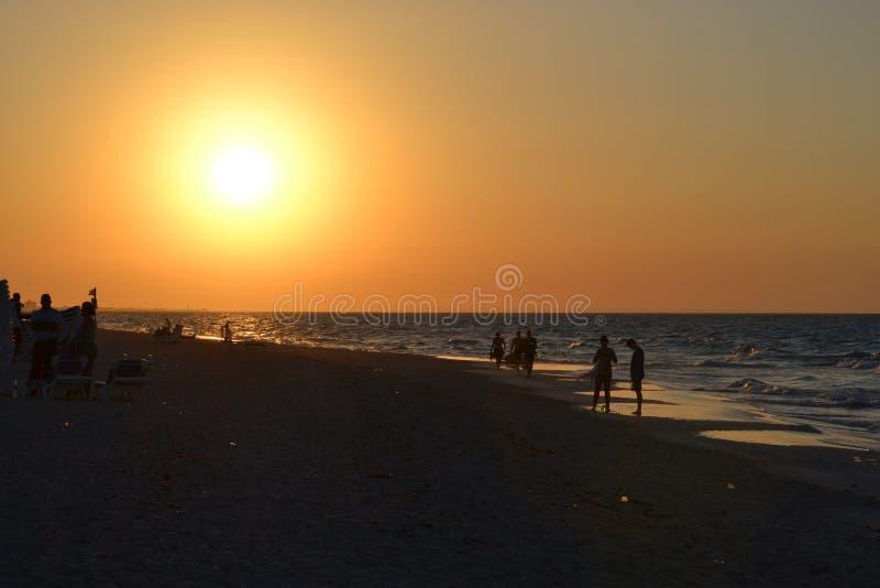 Sun setting over beach stock photo
