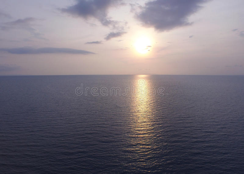 The sun setting over the calm sea in Thailand. Photo by drone stock images