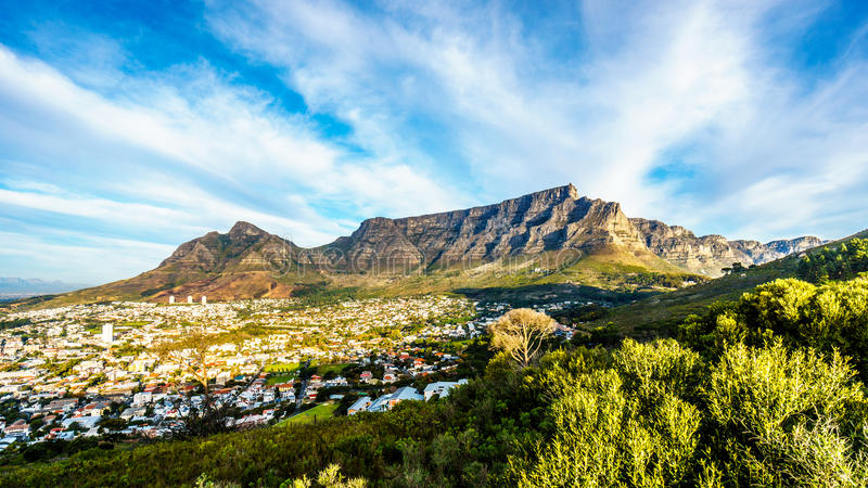 Sun setting over Cape Town, Table Mountain, Devils Peak, Lions Head and the Twelve Apostles. Viewed from the road to Signal Hill at Cape Town, South Africa royalty free stock images