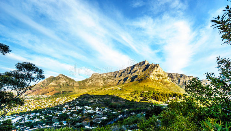 Sun setting over Cape Town, Table Mountain, Devils Peak, Lions Head and the Twelve Apostles royalty free stock photography