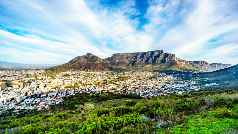 Sun setting over Cape Town, Table Mountain, Devils Peak, Lions Head and the Twelve Apostles. Viewed from the road to Signal Hill at Cape Town, South Africa stock photo