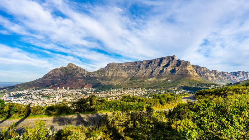 Sun setting over Cape Town, Table Mountain, Devils Peak and the Twelve Apostles. Viewed from the road to Signal Hill at Cape Town, South Africa royalty free stock photo