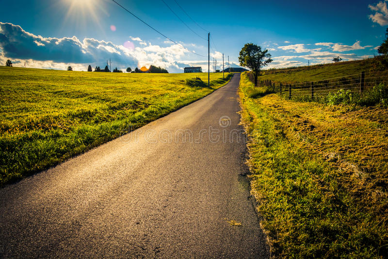 The sun setting over a country road near Cross Roads, Pennsylvania. royalty free stock photos