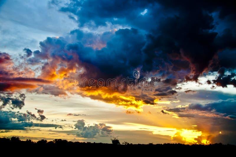 Sun setting over field stock photos