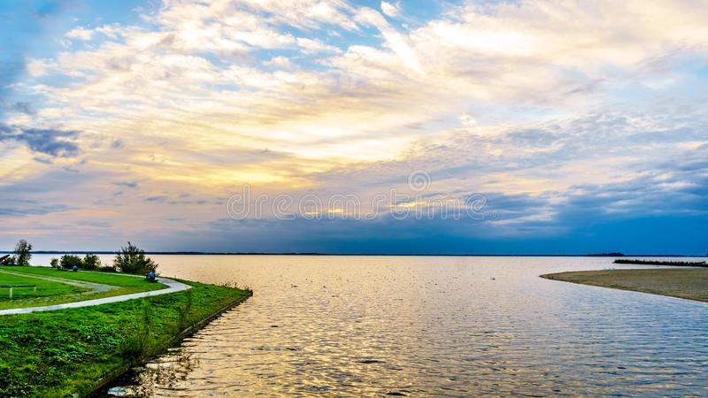 Sun setting over the harbor of Harderwijk in the Netherlands royalty free stock image