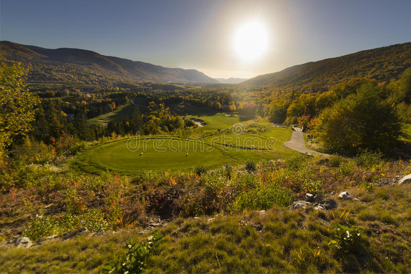 Sun setting over the Humber Valley golf course stock photography