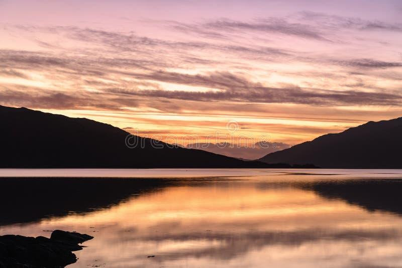 Sunart Sunset. The sun setting over Loch Sunart, Ardnamurchan, on New Years Day night. Scotland stock photos