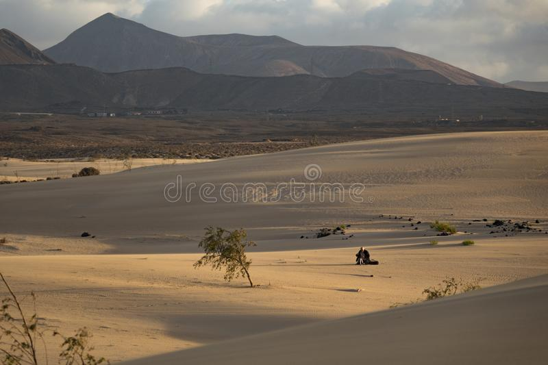 Sun setting over the mountains In the Natural Park Corralejo Fuerteventura Canary Islands Spain stock photography