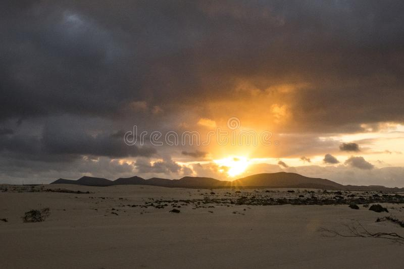 Sun setting over the mountains In the Natural Park Corralejo Fuerteventura Canary Islands Spain royalty free stock images