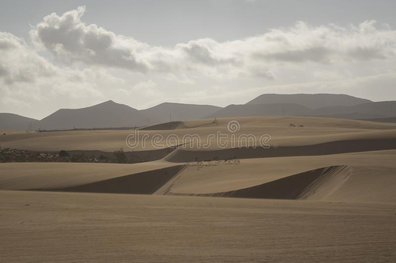 Sun setting over the mountains In the Natural Park Corralejo Fuerteventura Canary Islands Spain stock image