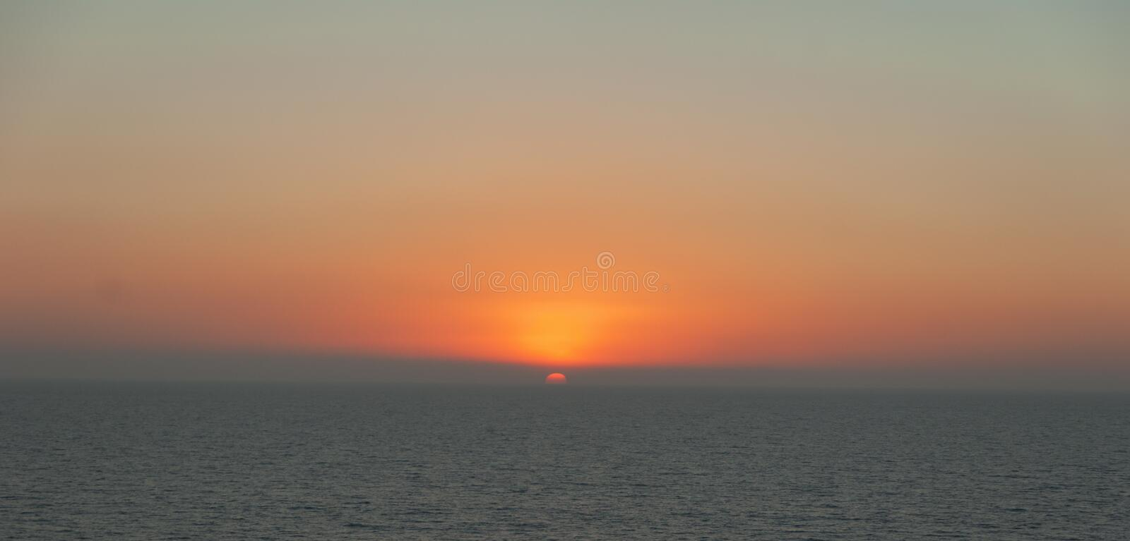 Sun Setting over the Pacific Ocean. Image showing the sun setting over the Pacific Ocean in Southern California royalty free stock images